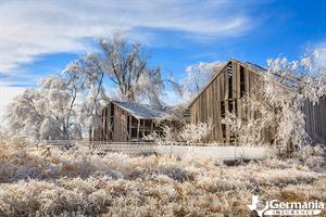 Snow and ice covered barn during a polar vortex in Texas