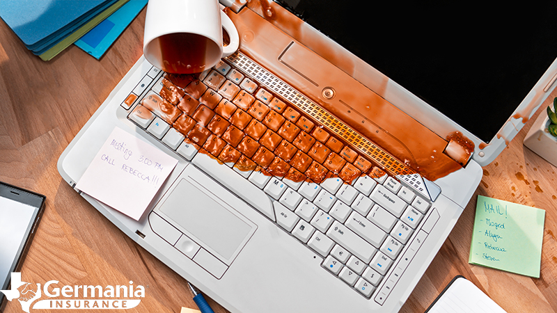 A ruined computer covered in spilled coffee emphasising the need for cloud storage.