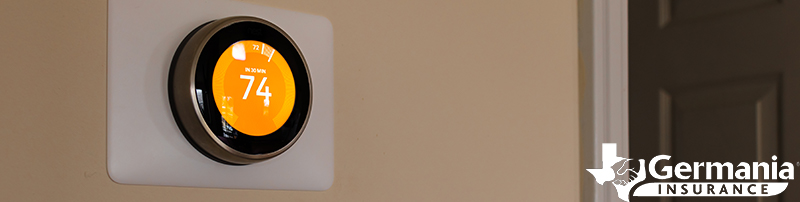 A Nest smart thermostat displaying 74 degrees