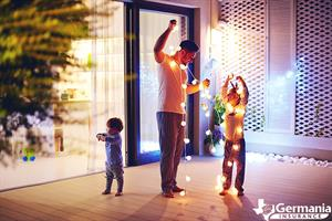 A father and his children safely decorating with Christmas lights