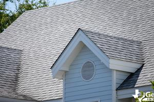 A house with asphalt shingles, demonstrating the different types of roof shingles.