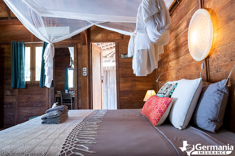 An Airbnb property bedroom with a bed and amenities