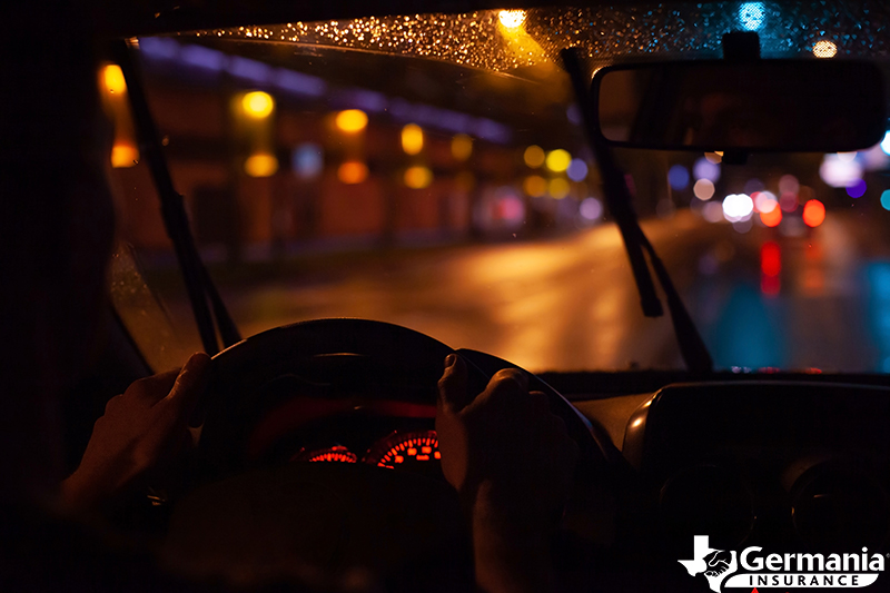 A man driving at night