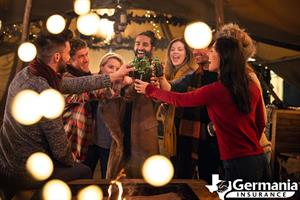 Several friends celebrating together, toasting at a holiday party.