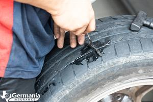 Fixing a flat tire with a tire plug kit