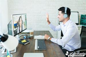 Two people on a video conference call while working from home.