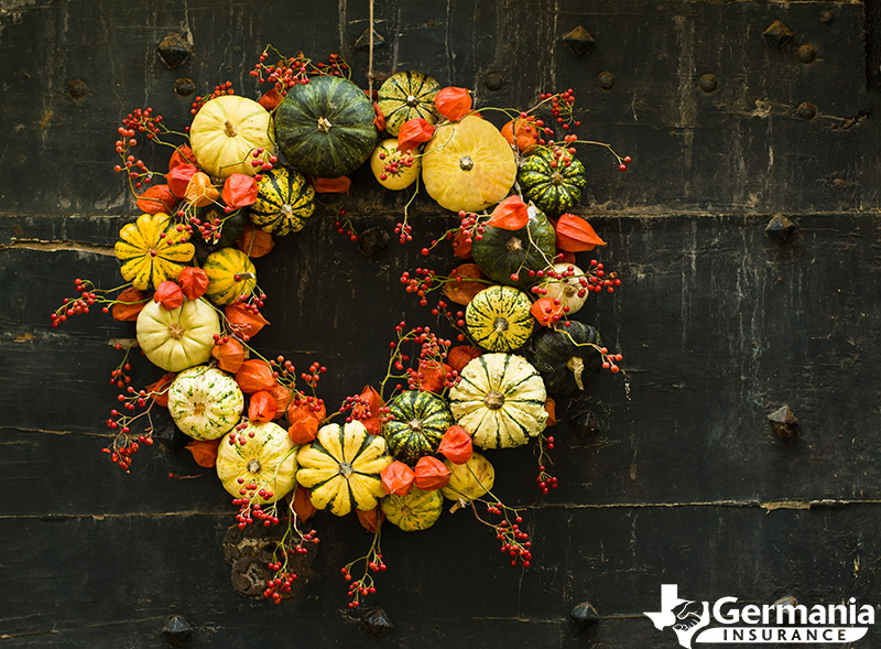 A DIY fall wreath with pumpkins and other fall decorations