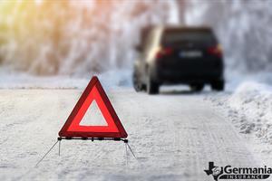 An emergency triangle from a winter roadside emergency kit