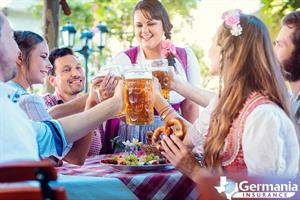 A group of people toasting with beer mugs at Oktoberfest in Texas
