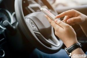A person using an safe driving app to prevent distracted driving