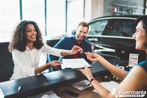 A woman receiving keys to a rental car