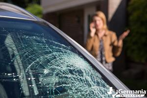 A woman considering whether to repair or replace her damaged windshield.