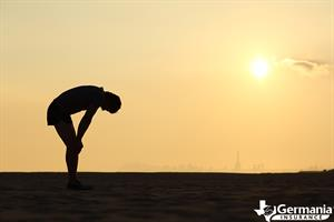 A silhouette of a man showing signs of heat stroke or heat exhaustion