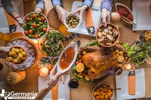 A Thanksgiving table with turkey and other Thanksgiving menu items