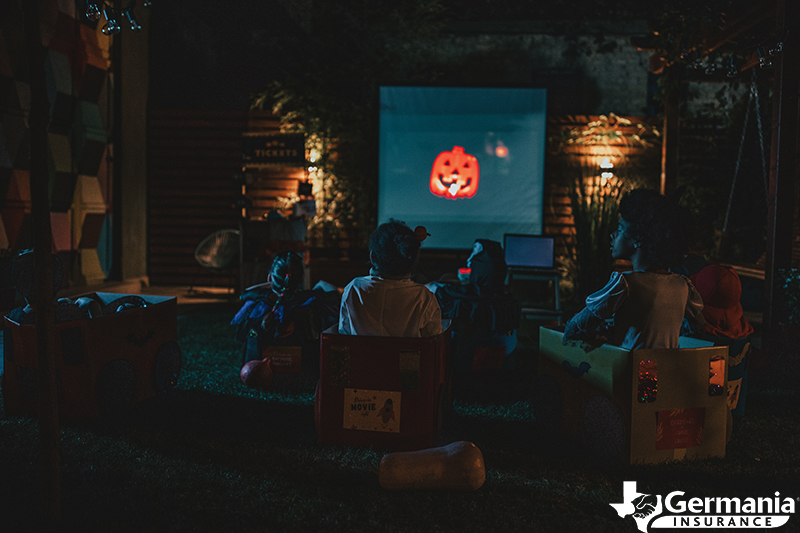 Kids watching a Halloween movie as an alternative to trick-or-treating