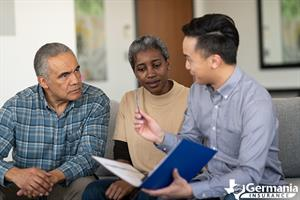 An elderly family speaking to their insurance agent about what happens when their term life policy expires.