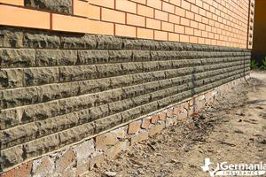 A brick and concrete foundation settling