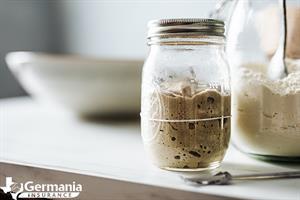 A jar of leftover sourdough starter discard